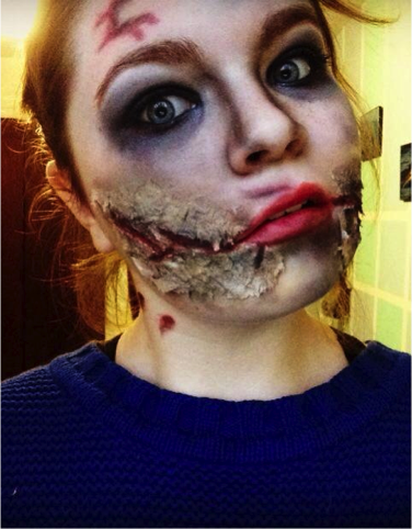 Sophomore Jenna Taylor embracing Halloween in true style as a zombie yoga instructor.