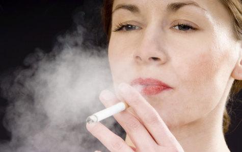 A woman smoking a cigarette. Photo courtesy of WebMD.