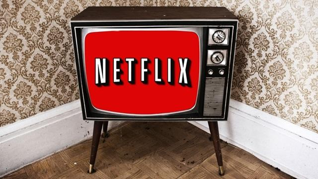 A image of a television screen and the Netflix logo appearing on the screen.