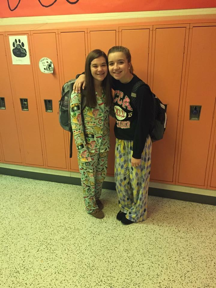 West sophomores Haleigh Ginder and Sophia Downes pose for a picture on the first day of homecoming week, pajama day, Monday, October 5, 2015. Photo by Micaela Harris.
