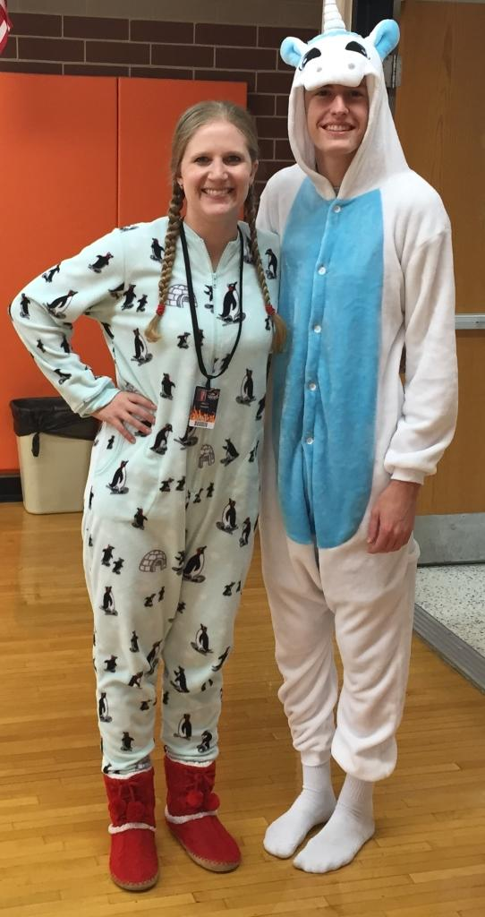 Mrs Sharer and Kyle Bassett dressed up for pajama day in onesies