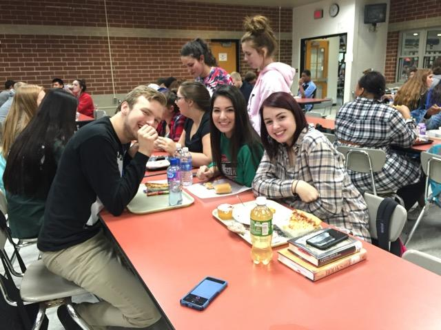 Students Brandon Cary (12), Abby Craig (12) and Sara Yoder (11) talk about why they love animals during their lunch.