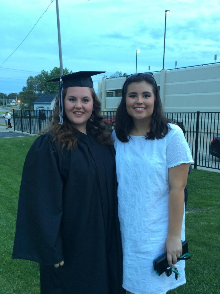 NCWHS alumni, Elli Alvis, and current Paw Print Editor in Chief, Micaela Harris, pose after the class of 2015 was handed their diploma's at the US Cellular Coliseum.