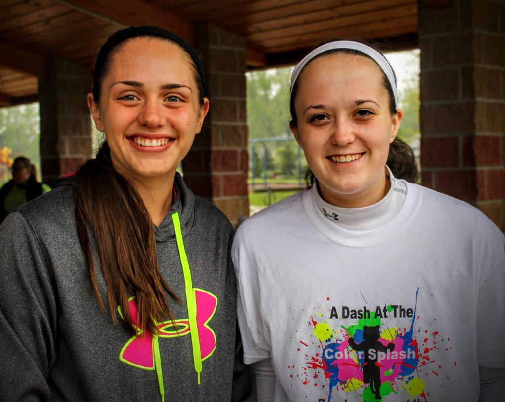 Normal West sophomores Maggie Rena and Dani Freeman pose for a photo prior to running in the FMP Color Splash 5K.