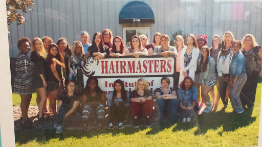 The BACC students in cosmetology pose in front of the Hairmaster's School.