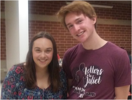 """Emily Hapgood (12) and Nicolas Koch (12) hang out in the senior cafeteria. They both starred together in this year's musical,""""White Christmas"""", and play, """"Harvey"""". They both have been leaders in the Wildcat theatre program."""