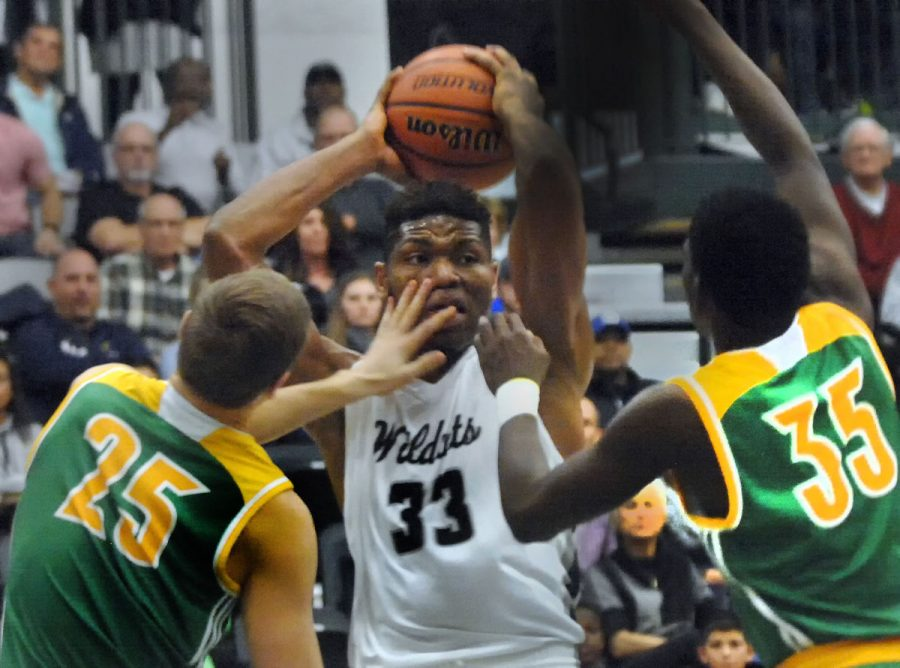 Francis Okoro (11) grabs a rebound against U-High in the Intercity Tournament.