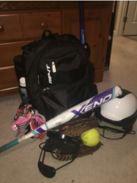 Photo of one of the players' softball gear prepared for tryouts.  Photo by Lauren Adcock.