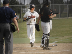 Sophomore Will Kaferr scores a run in the third inning of Thursday