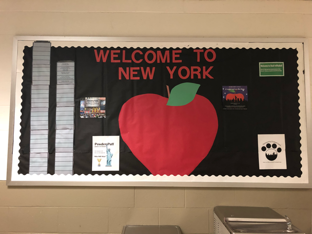 Since the theme of the dance is New York, the bulletin board is decorated with New York related things.