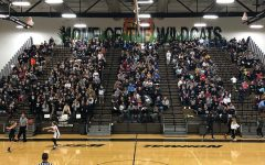 Wildcat fans pack the stands in support of the girls basketball team.  The JV team was in a tragic bus accident the previous night.