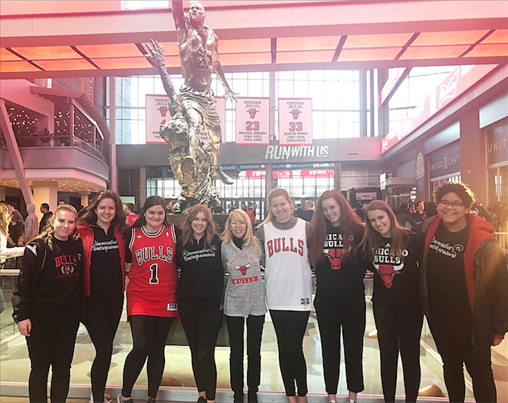 A+group+of+IE+students+stand+in+front+of+the+famous+Michael+Jordan+statue+from+the+famed+1990%E2%80%99s+team+that+has+become+a+staple+for+Chicago+history.+