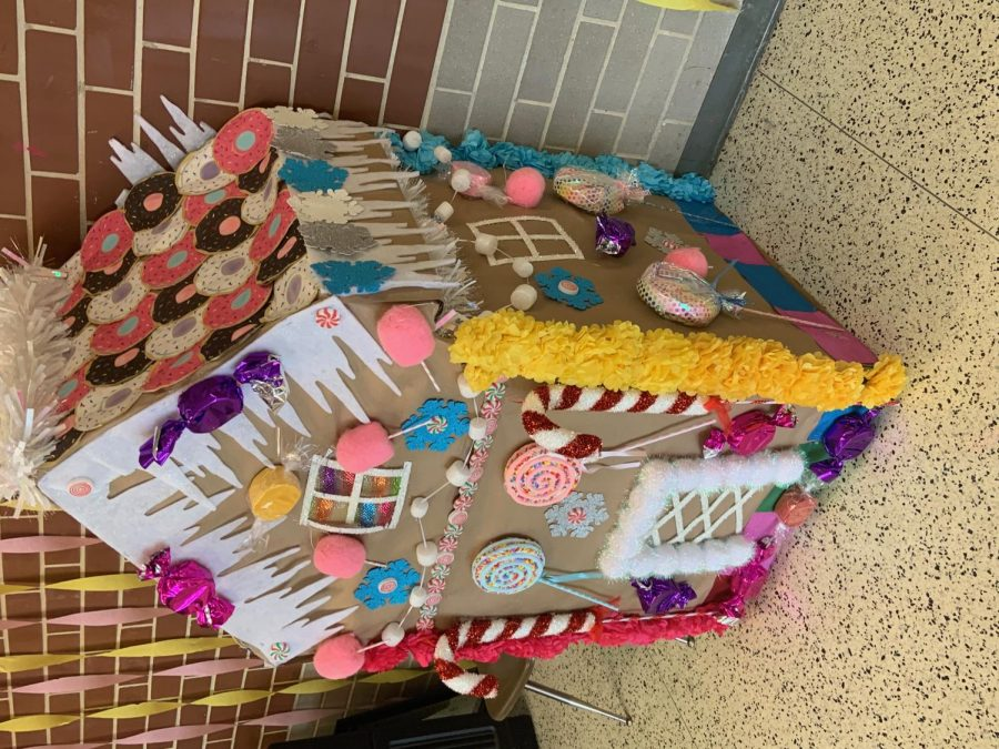 The candy land house located in the senior cafeteria brings a interesting view to the decorated hall.